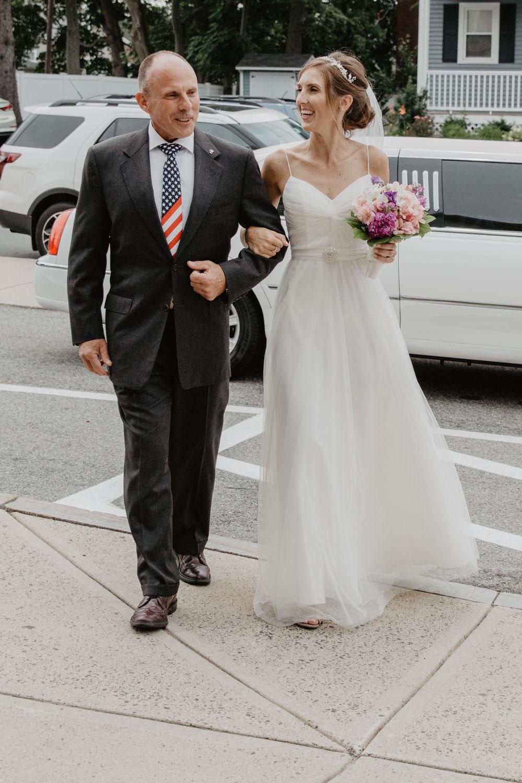 Bride arrives at Saint Patricks church in Stoneham MA