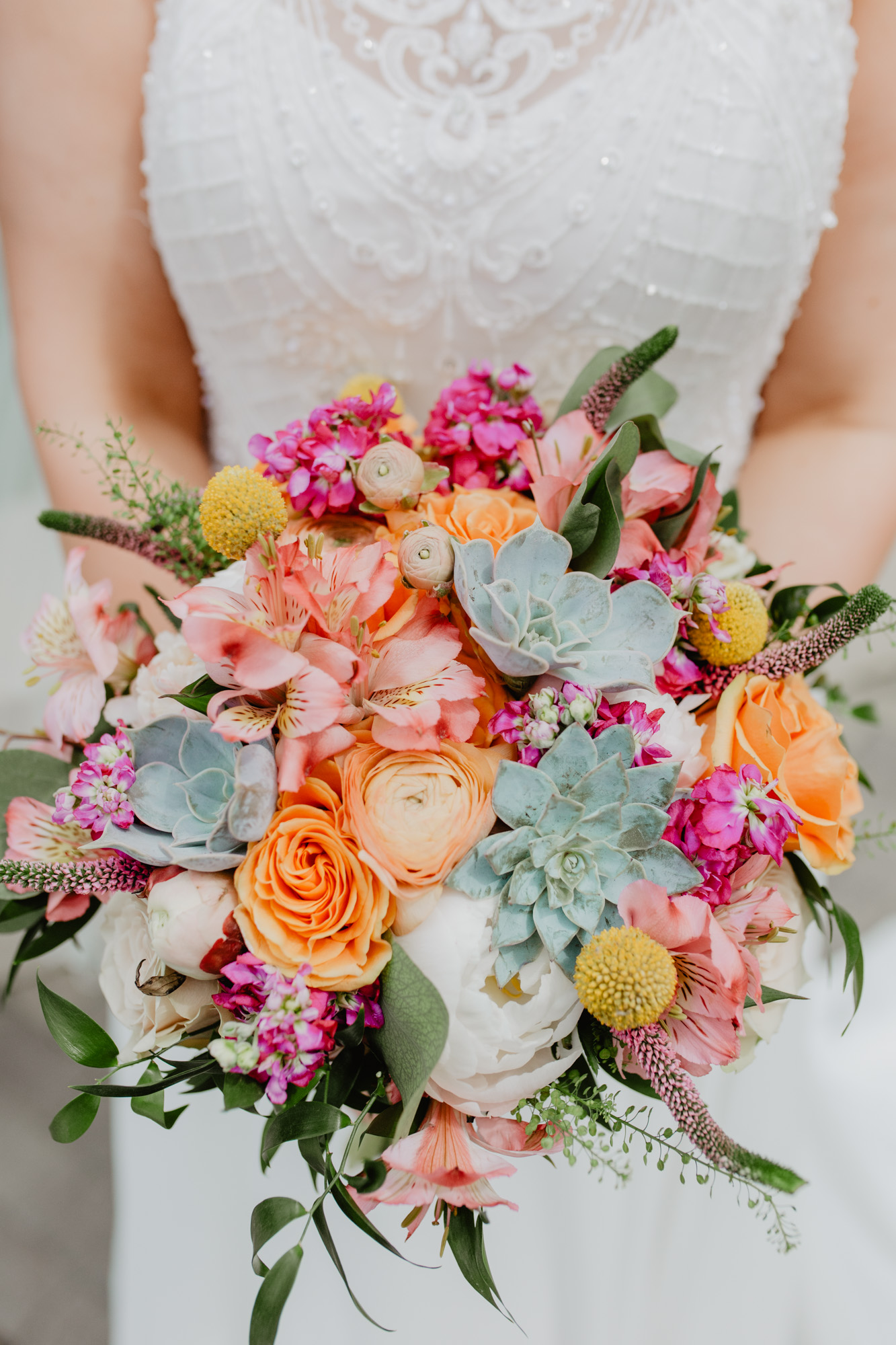 Colorful bridal bouquet with succulents. Florals by Michele Bernard, Boston
