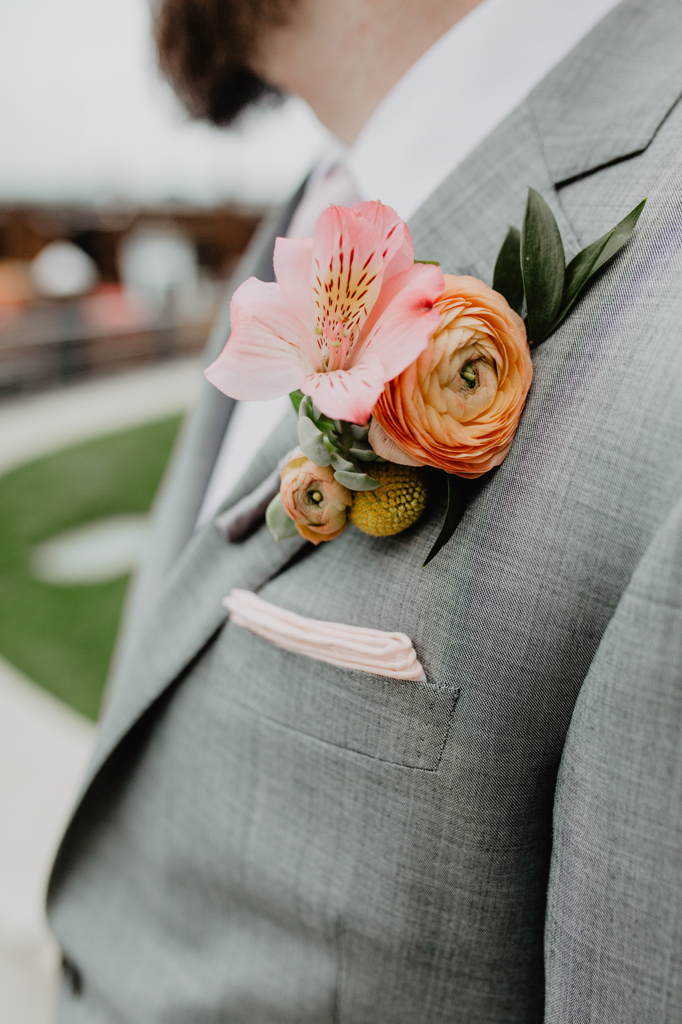 Groom's colorful, orange boutonniere