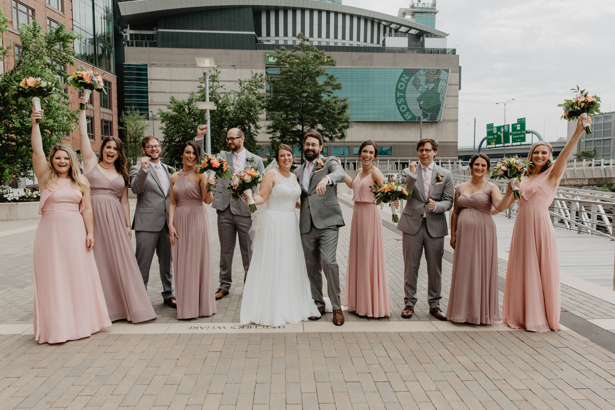 Bridal party poses at Lovejoy Wharf in front of the TD Garden
