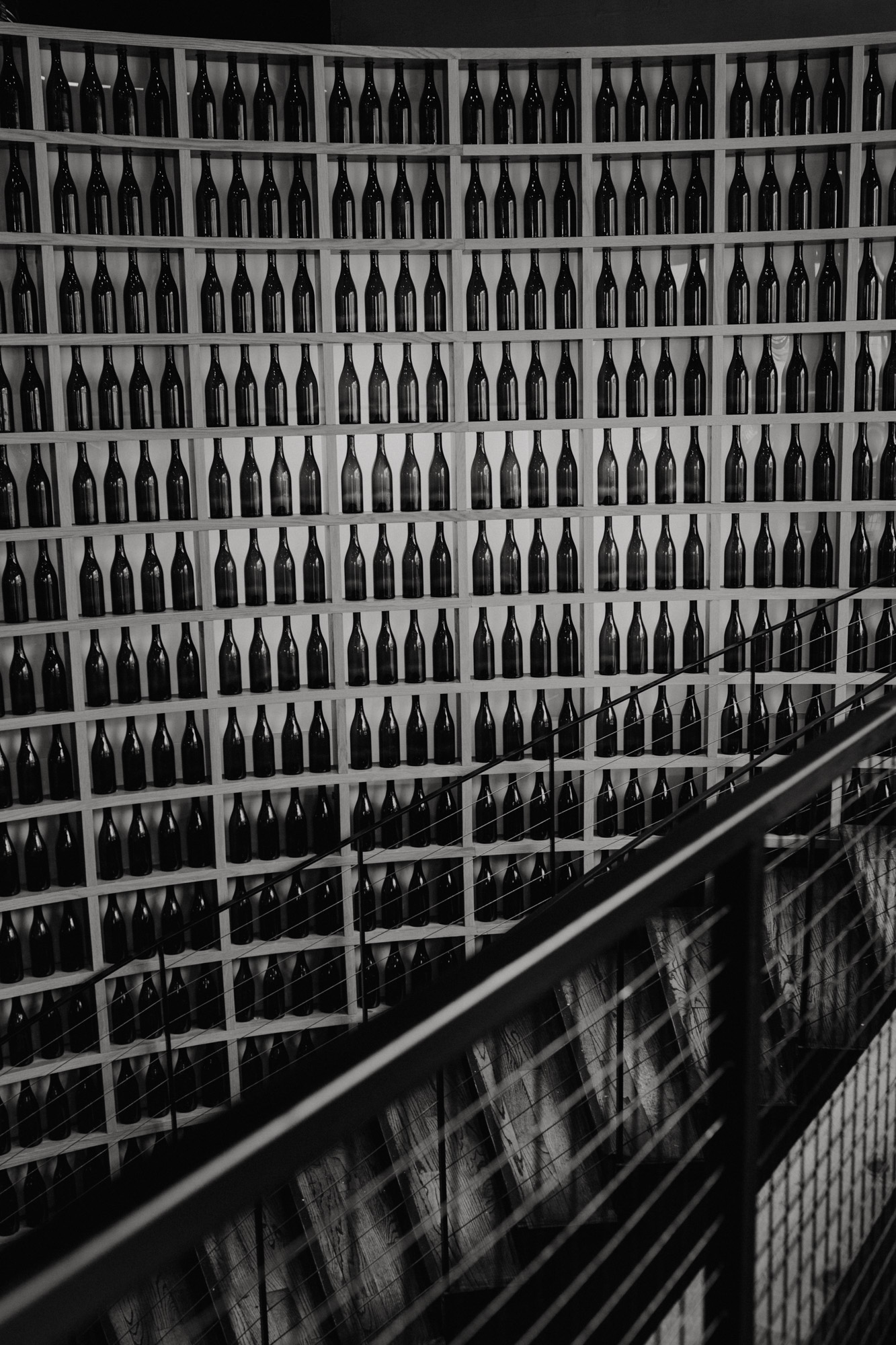 A wall of wine bottles at City Winery Boston