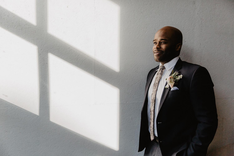 The groom poses at Warehouse XI wedding