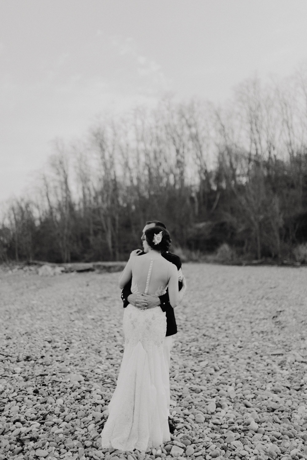 A portrait of the bride and groom on the Oceaview of Nahant's beach