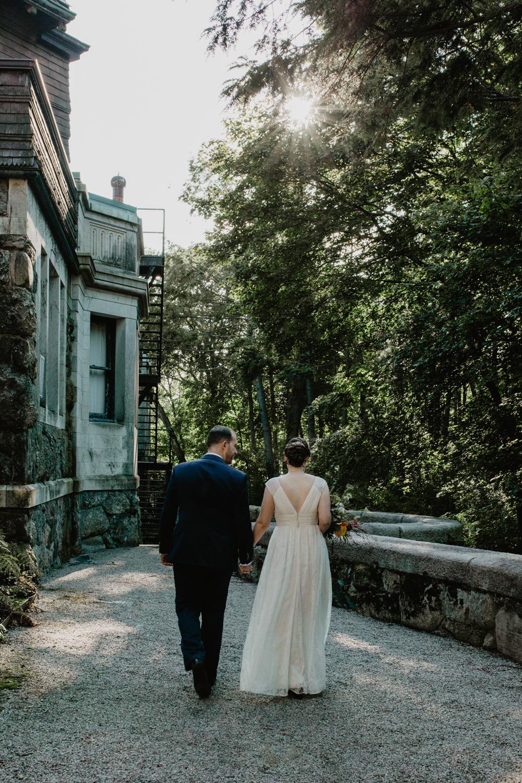 Bride and groom walk outside of the Dane Estate