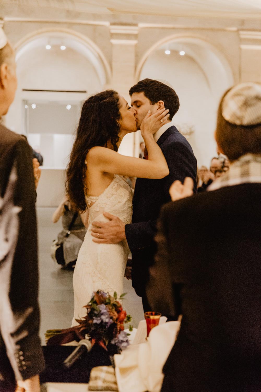 Bride and groom kiss at Harvard Art Museum wedding ceremony
