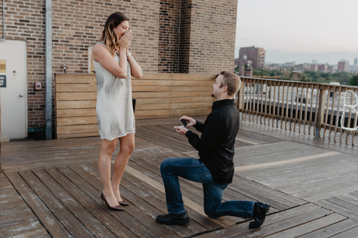 A marriage proposal on a rooftop in Boston