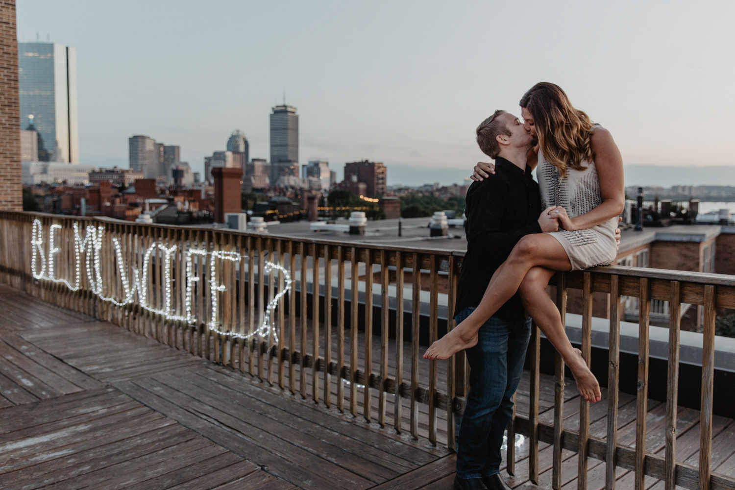 Rooftop proposal in Boston at sunset