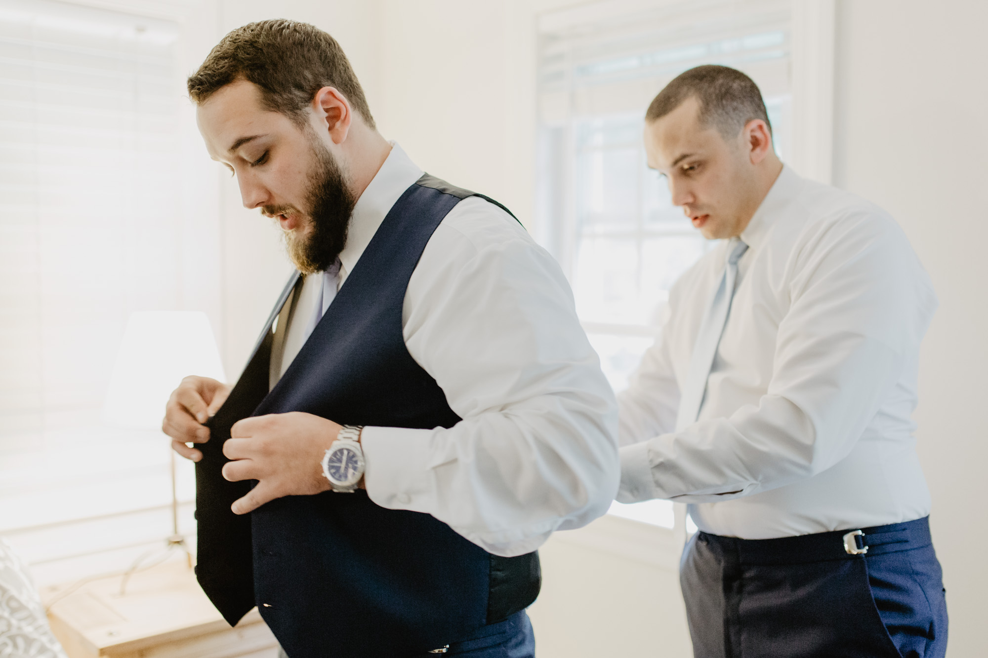 The groom and his best man get dressed for the wedding