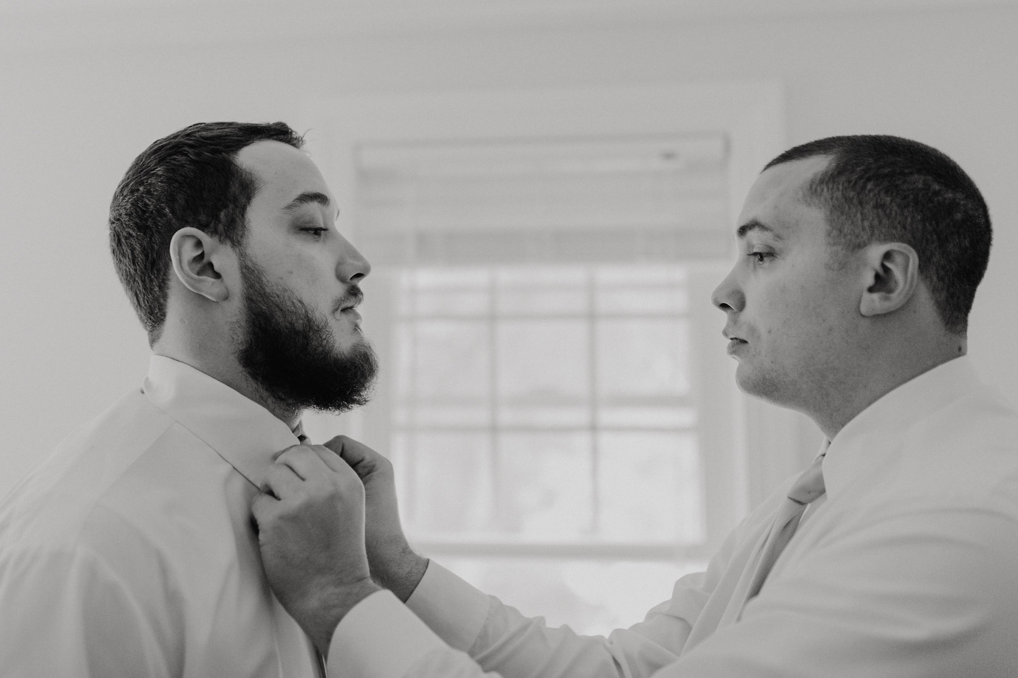 The groom and his best man prepare for the wedding
