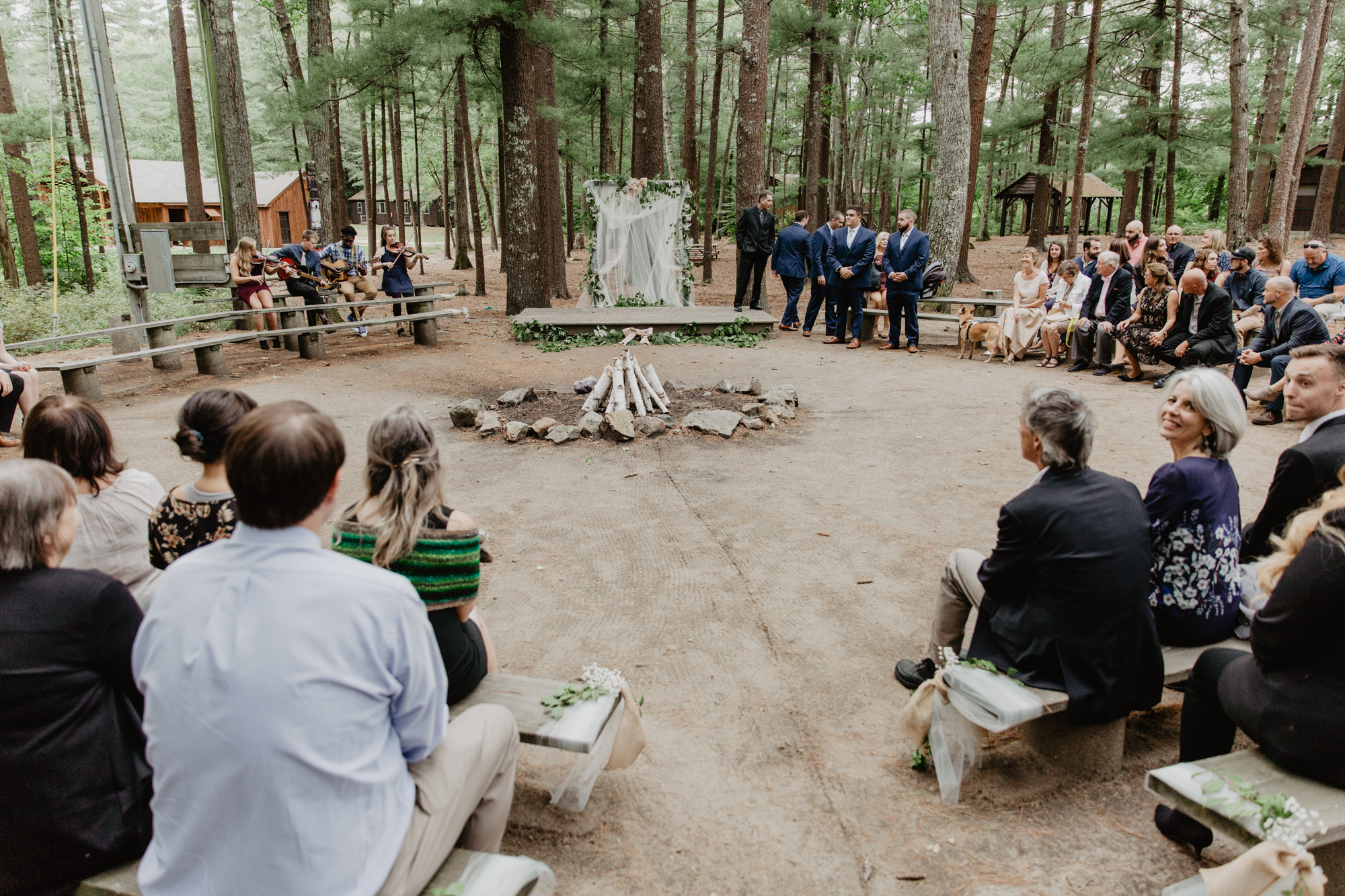 A wedding ceremony in the woods at Camp Wing summer camp