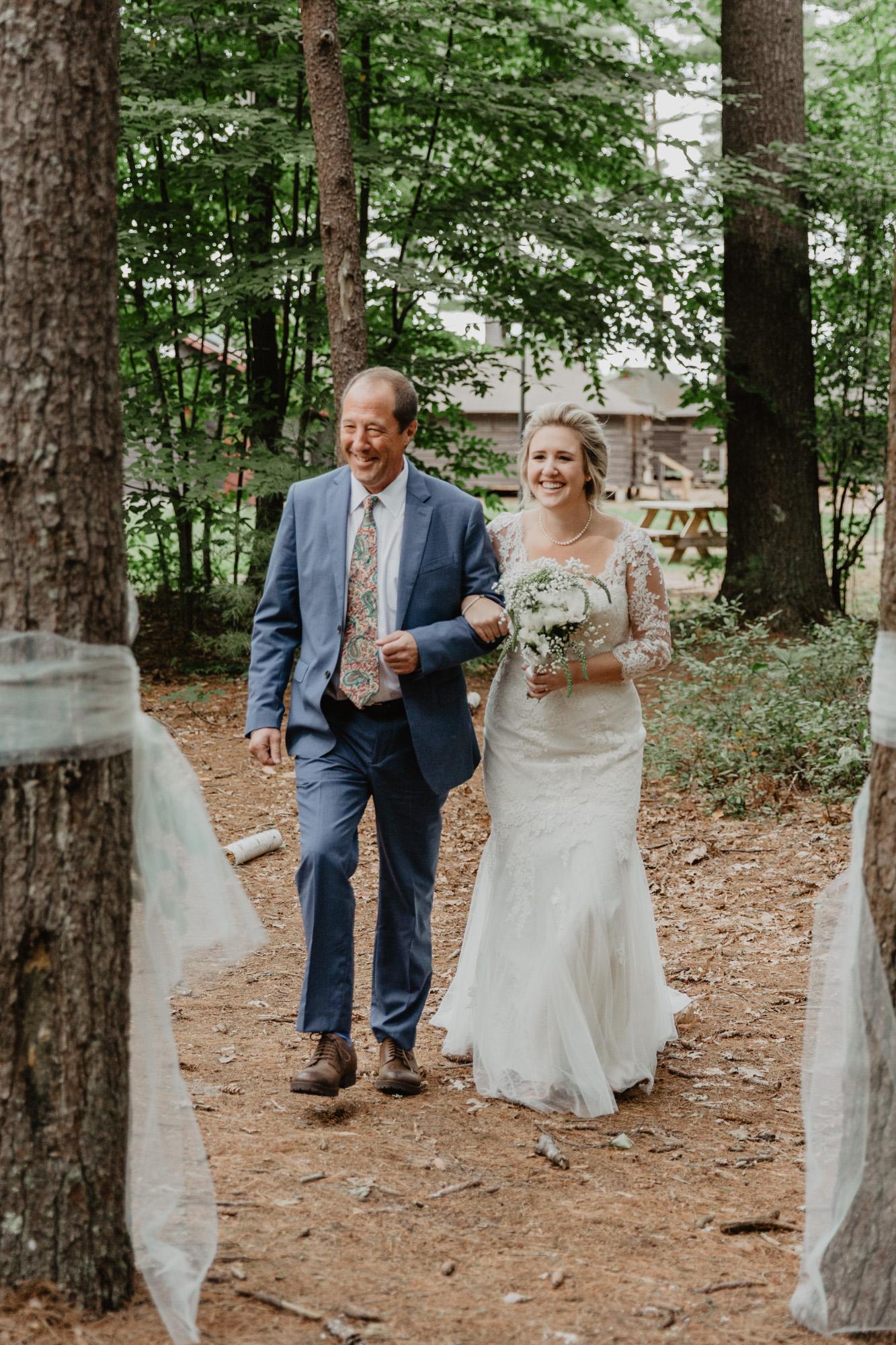 The bride enters her summer camp wedding in Duxbury MA