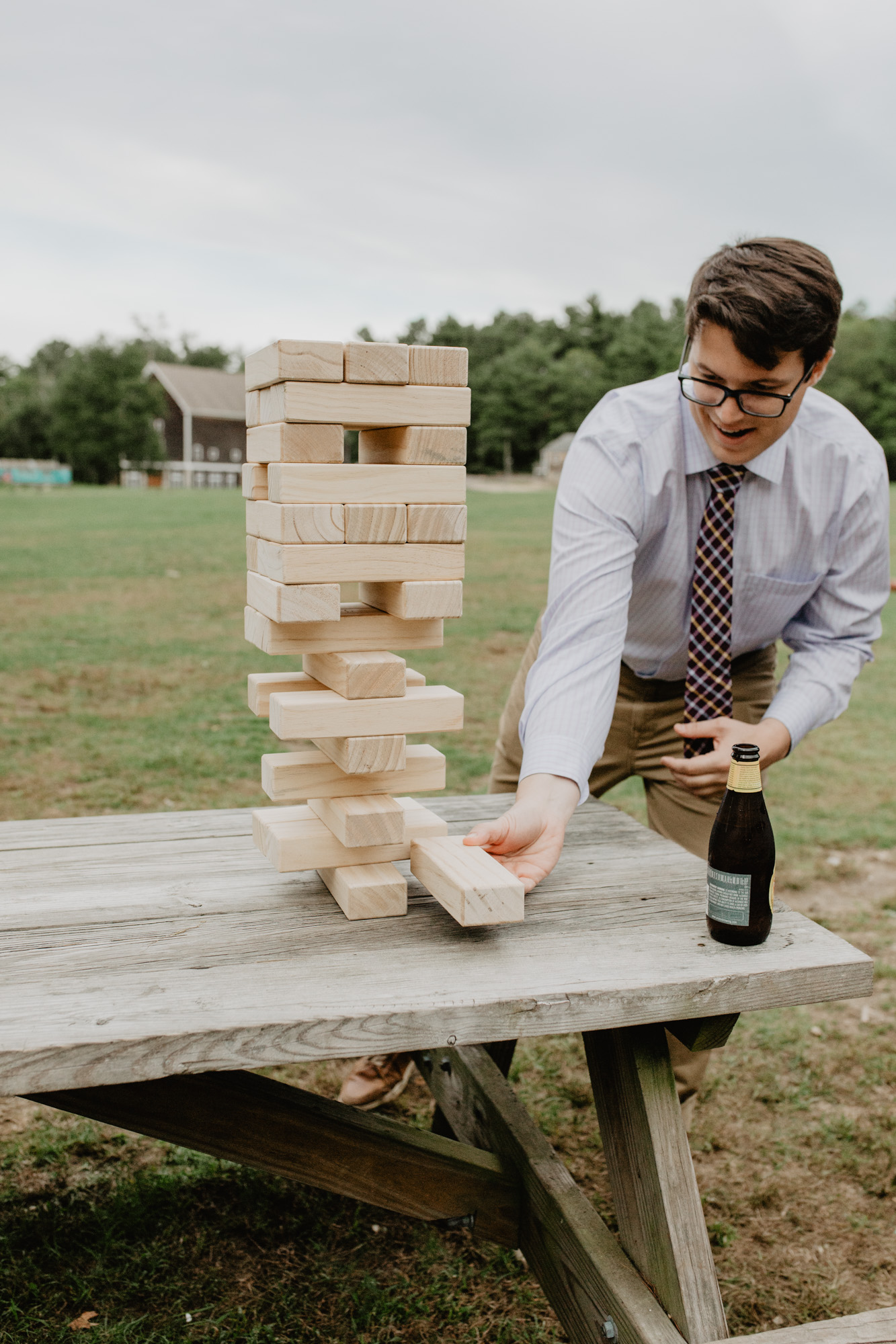 A wedding guest plays a game of Jenga