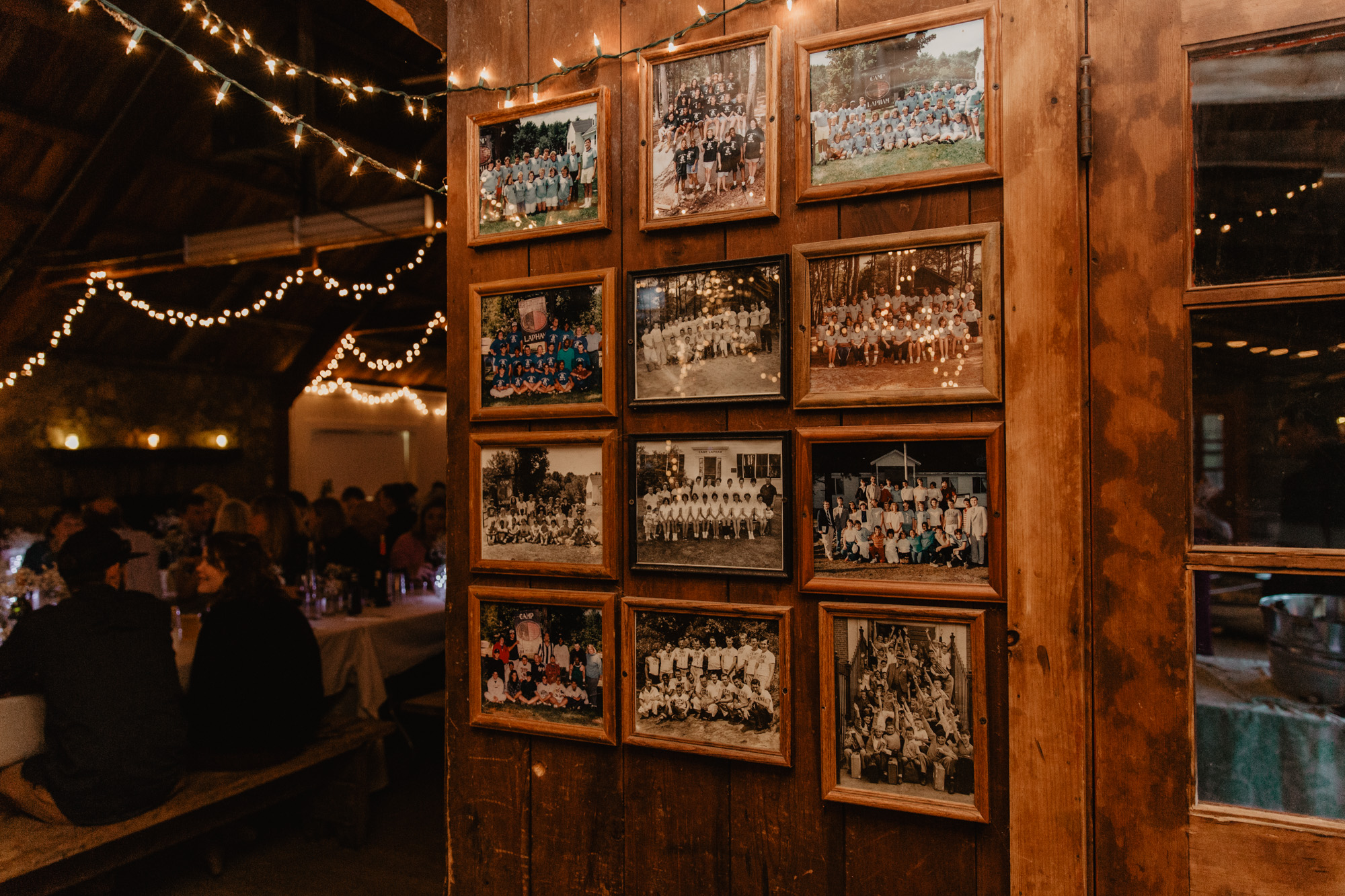Old photos of campers hang in the Camp Wing mess hall