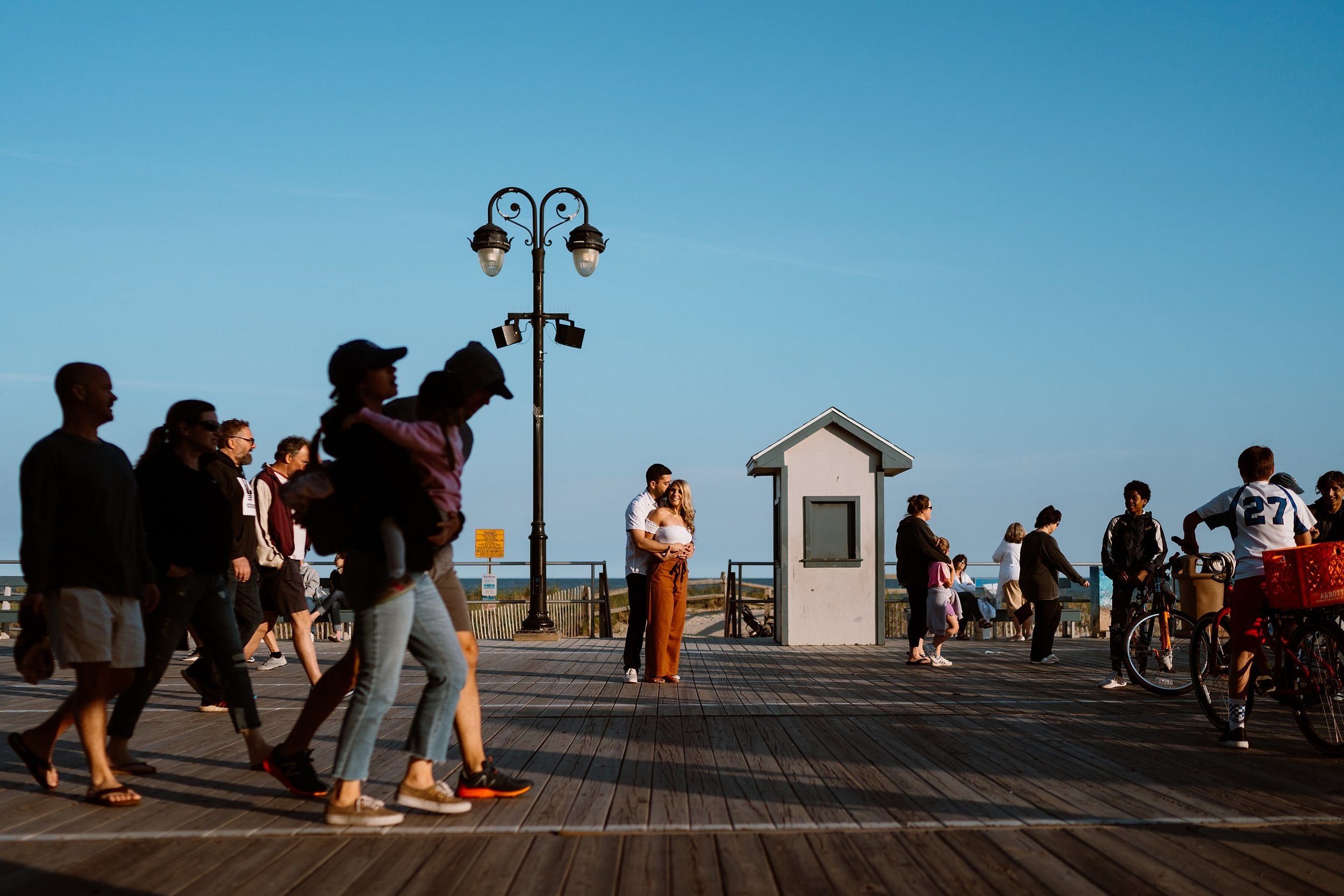 Ocean city boardwalk engagement photo