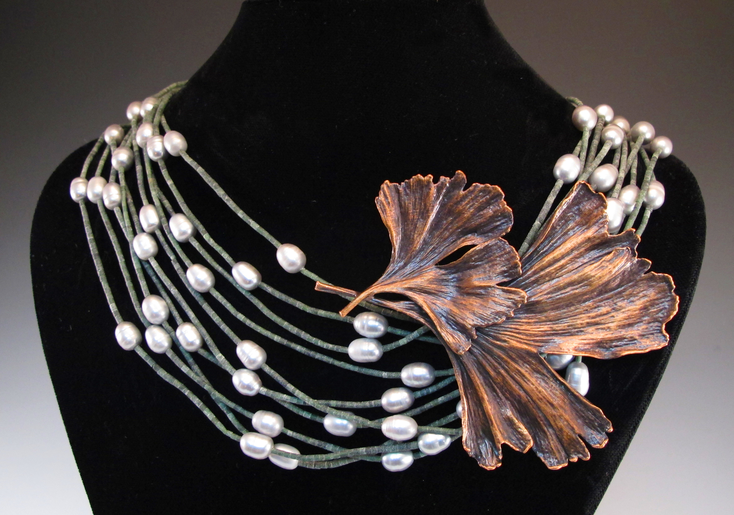 Bronze Double Ginkgo on Pearl-Green Necklace.jpg