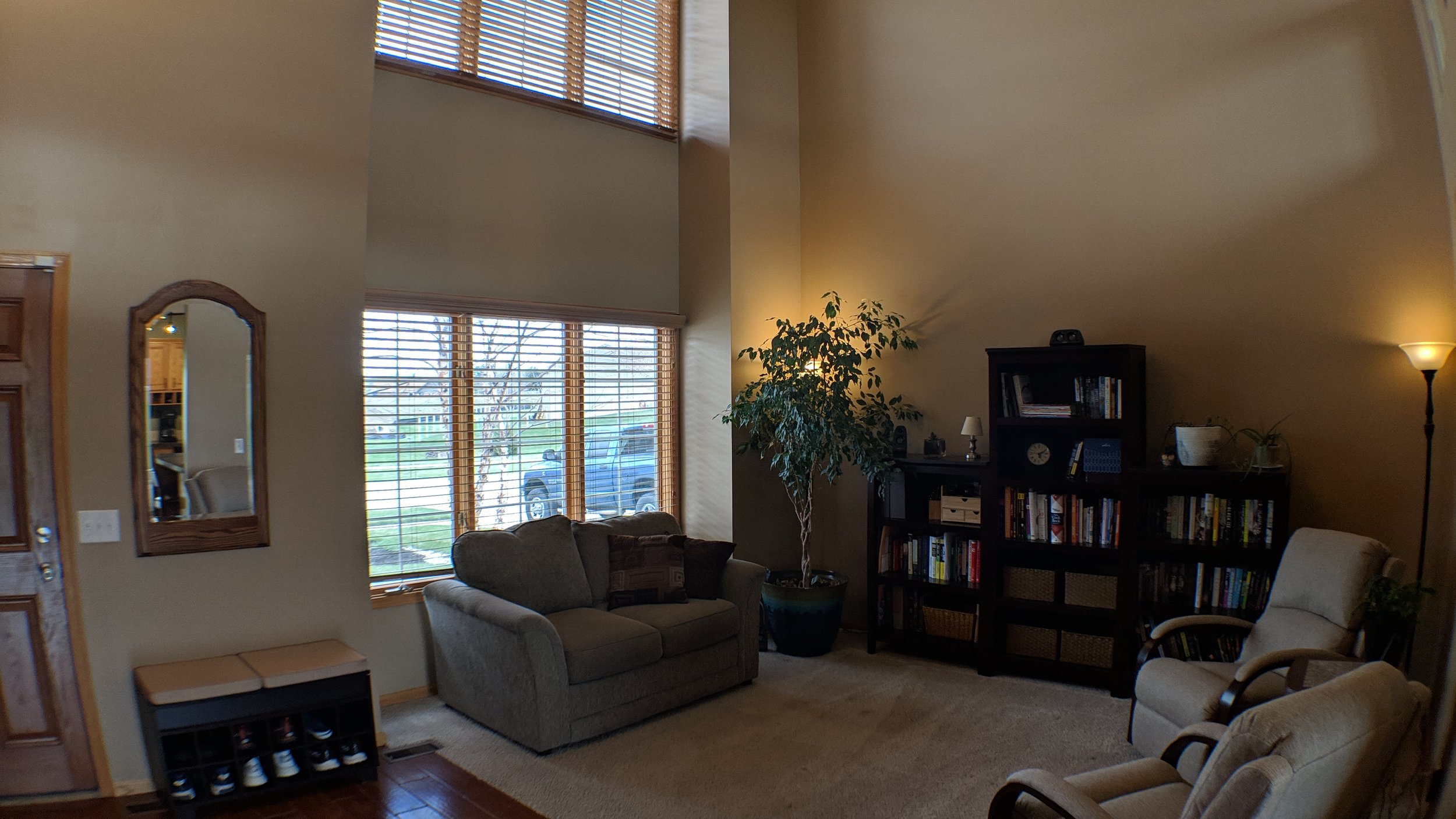 Two story front room and foyer with great natural light!