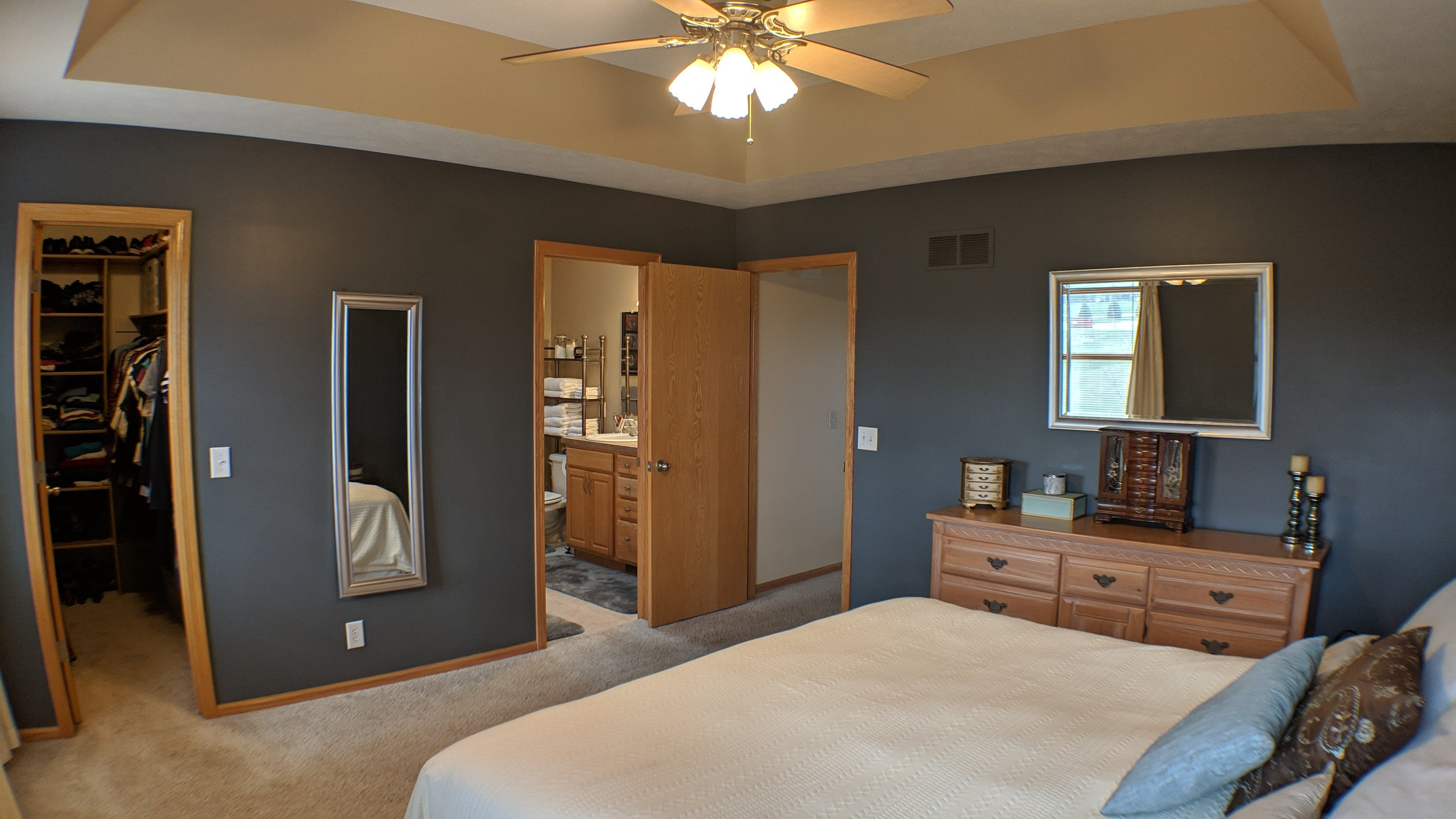 Large master suite with walk-in closet and double vanity.