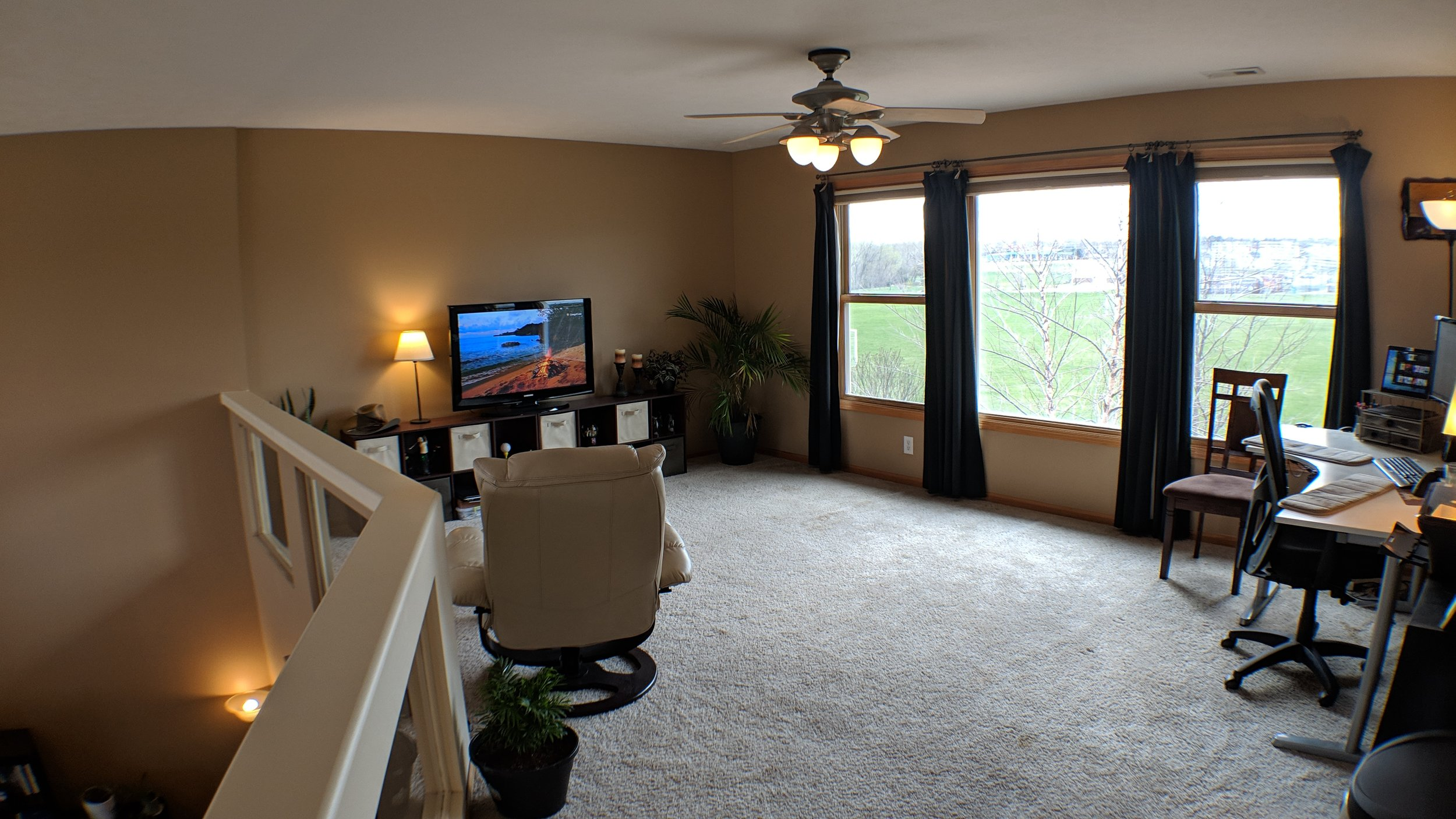 Large loft/office with view of open space and back yard retreat!