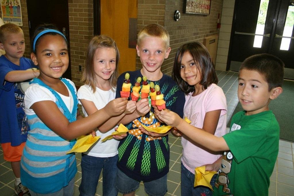 Children enjoy fruit at a summer meal site