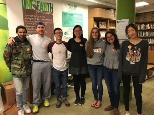 Caption: UC San Diego students wear orange buttons to show they are taking the #CalFreshChallenge.