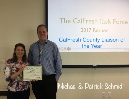 San Diego Hunger Coalition Senior Director of CalFresh and Advocacy, Amanda Schultz Brochu presents Patrick Schmidt with the CalFresh County Liaison of the Year award. Patrick also accepted the award on behalf of Michael Schmidt who was unable to attend the CalFresh end of year meeting.