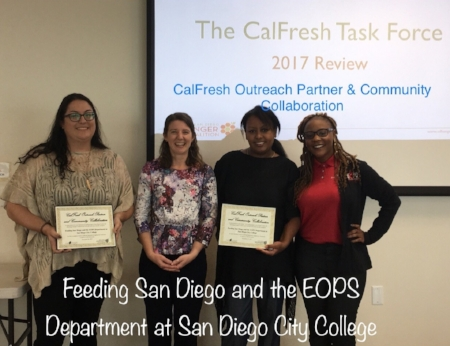 San Diego Hunger Coalition Senior Director of CalFresh and Advocacy, Amanda Schultz Brochu presents Rachel Oporto of Feeding San Diego and Salem Berhanu and Mercedes Tiggs of San Diego City College with the CalFresh award for Outreach Partner and Community Collaboration.