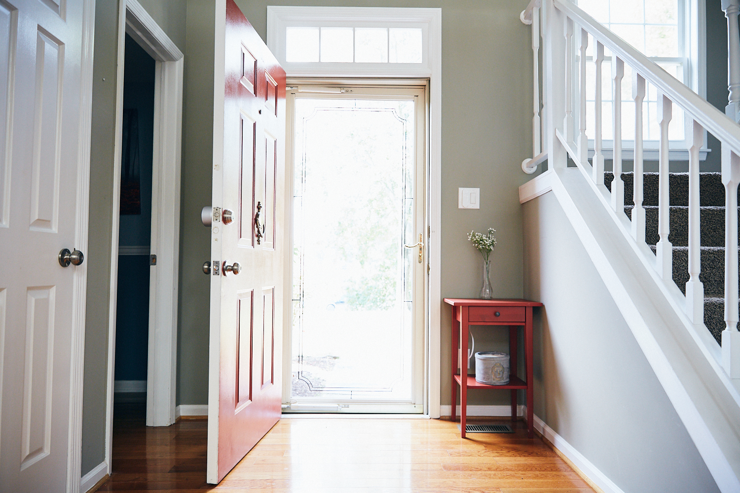 Entryway shot - replace red table with something else or remove