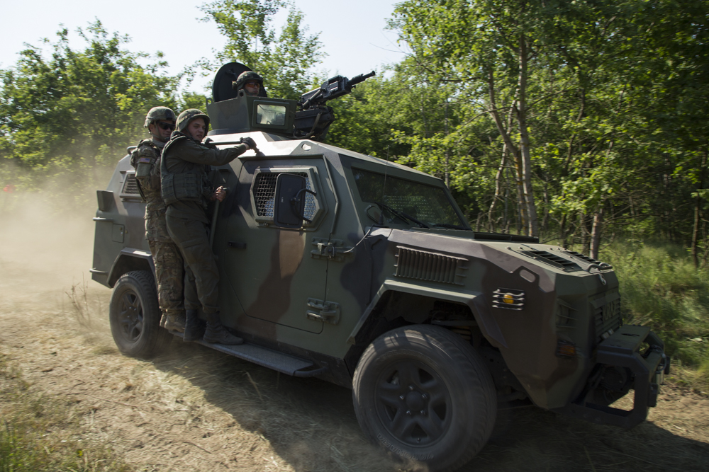 Ukrainian troops on a KrAZ truck during training exercises near the western city of Lviv, 2015.