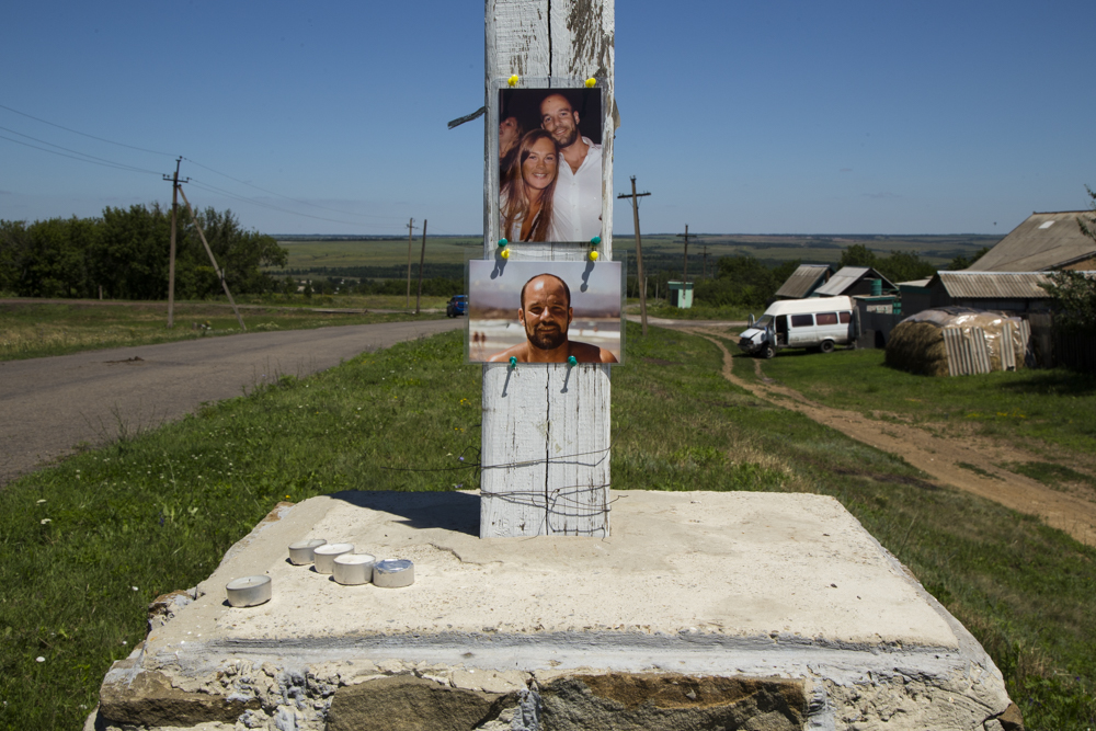 Pictures of Dutch victims of the MH-17 crash at a small memorial near Horlivka, Ukraine.