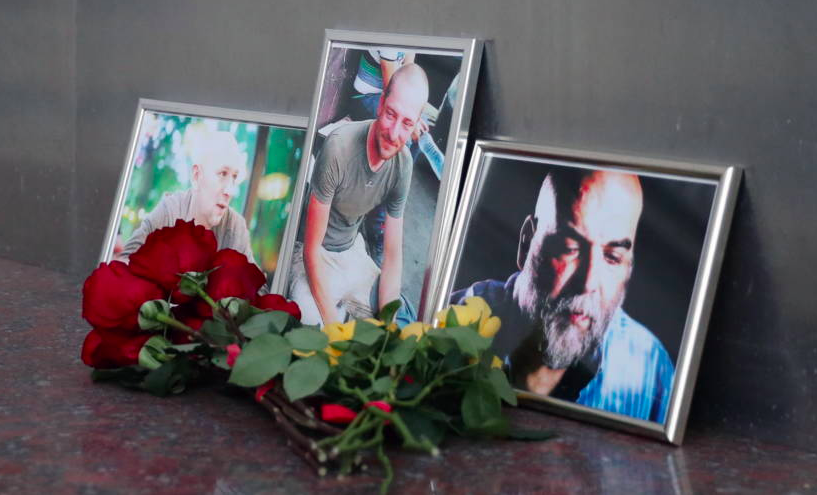 - Flowers brought to the Central House of Journalists in Moscow in memory of three Russian journalists killed in the Central African Republic. Sergei SavostyanovTASS
