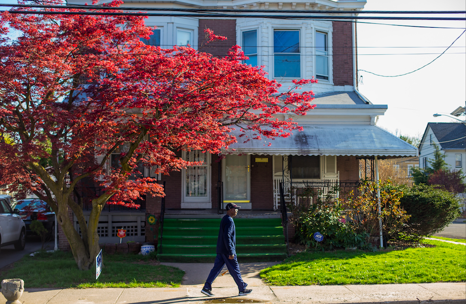 Julius Gallishaw walks in front of his house in Trenton, New Jersey.