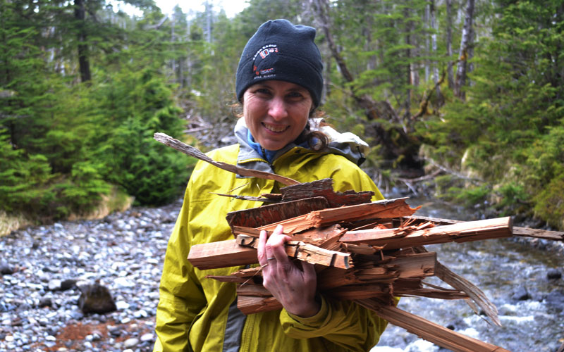 Stacey collecting wood