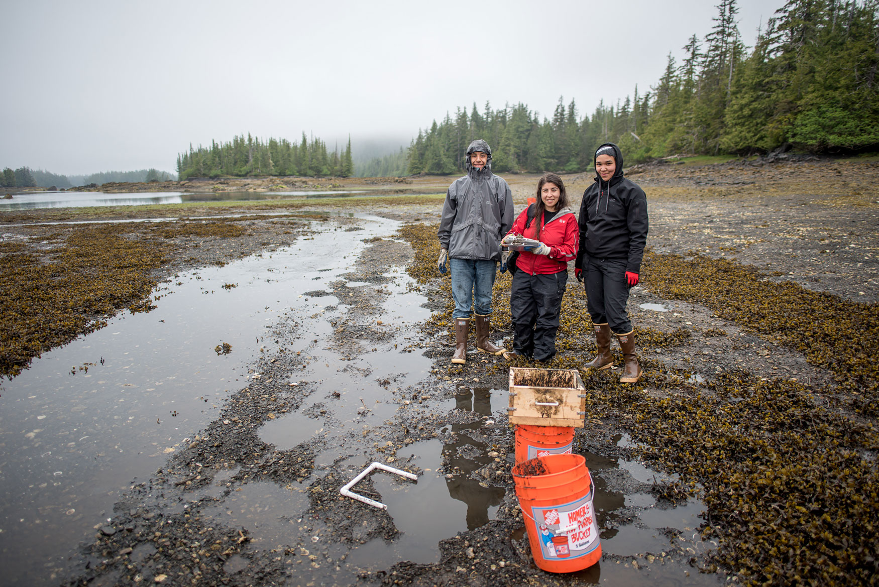 Joe, Sonia and Minnie at the Biscuit Lagoon beach collecting data to understand sea otter impacts on shellfish populations. Photo by Bob Christensen