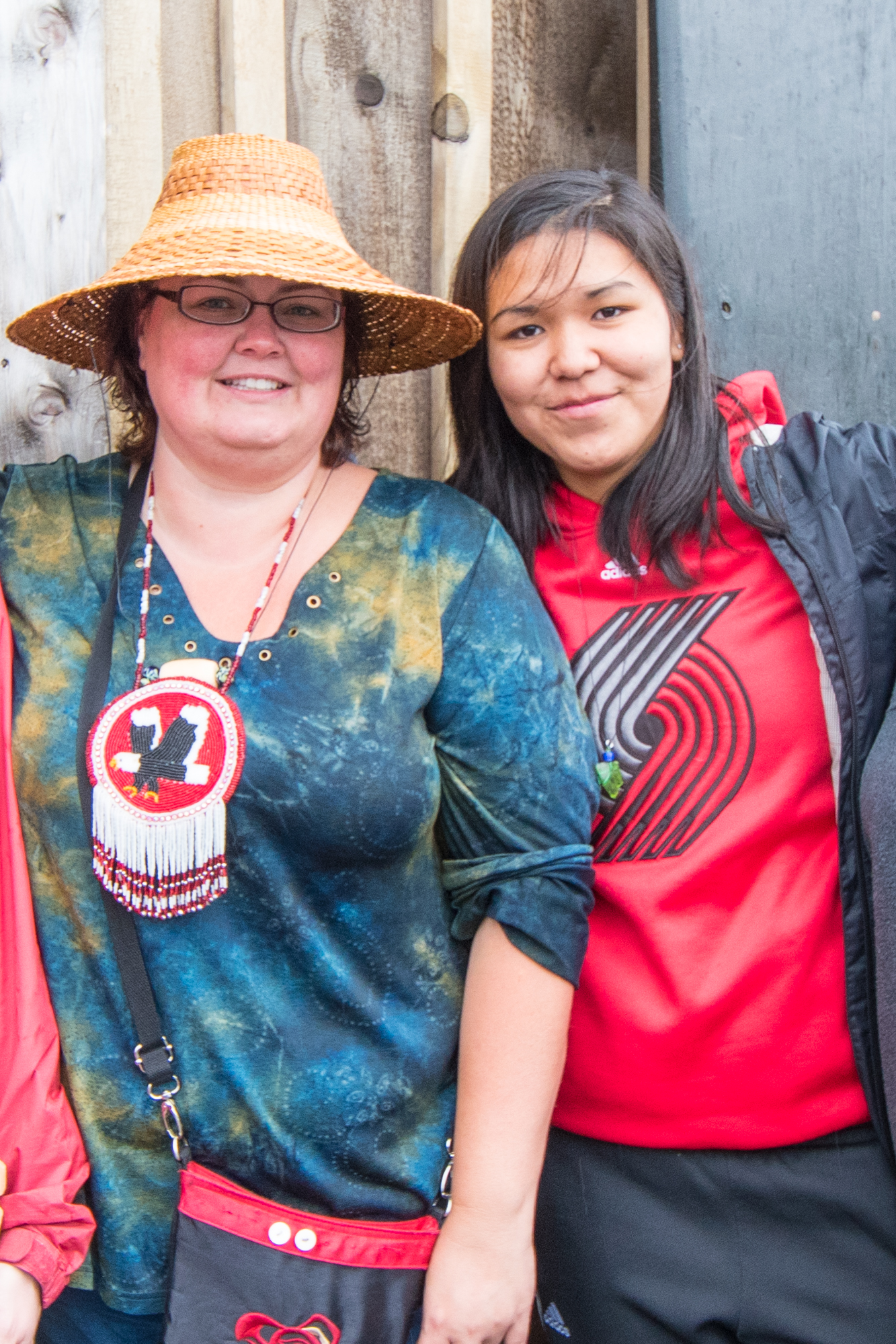 Wendy Smyth are bringing meaningful science to their home community of Hydaburg by science with culture. The two stand in front of the carving shed awaiting for the totem pole to be brought out during this year's Culture Camp.