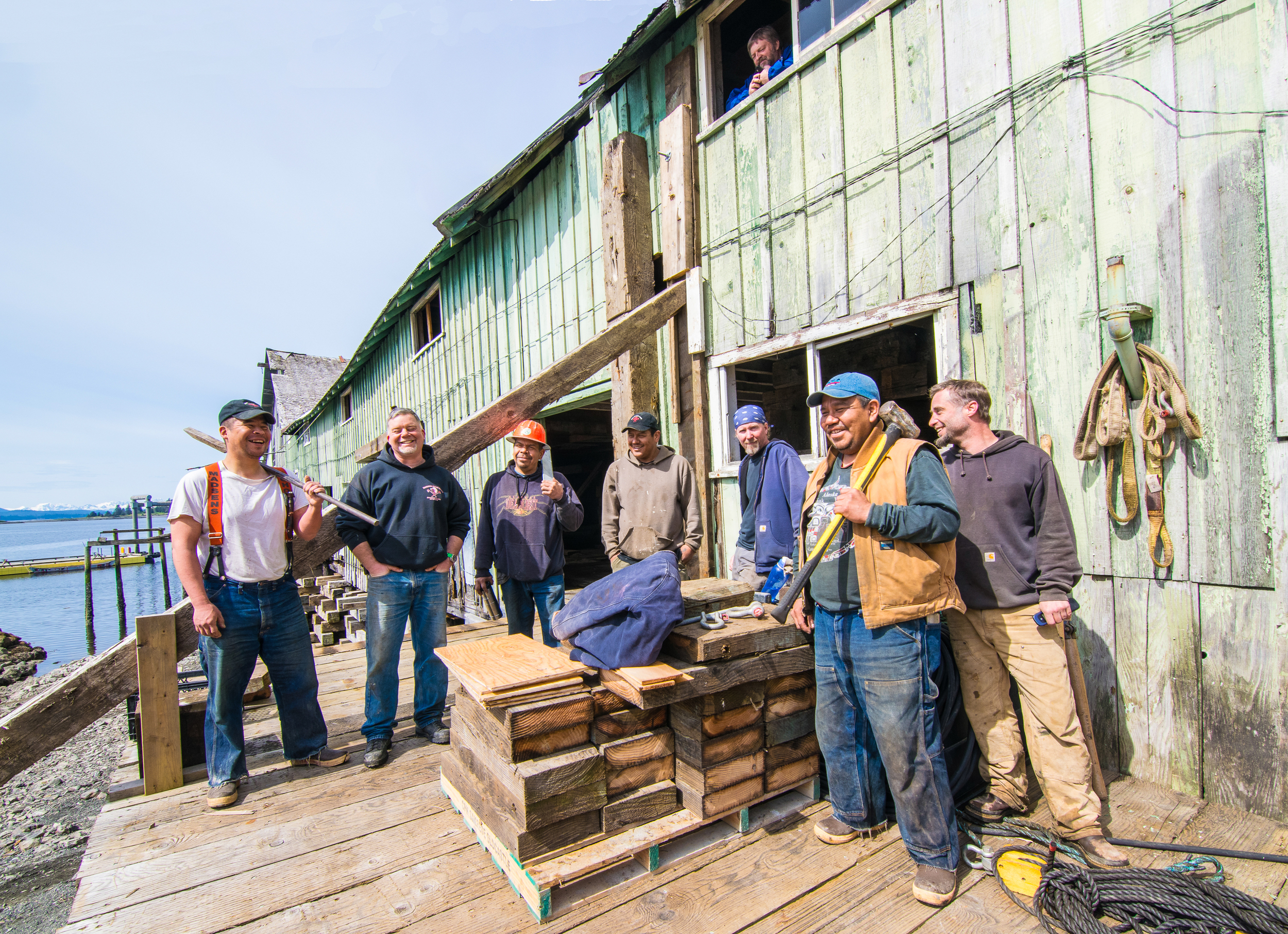 From a window in Kake's Historic Cannery, Gary Williams overlooks Greg Harrison and his construction crew. This hardworking team is inventive, fearless and includes five Kake locals (including Williams).