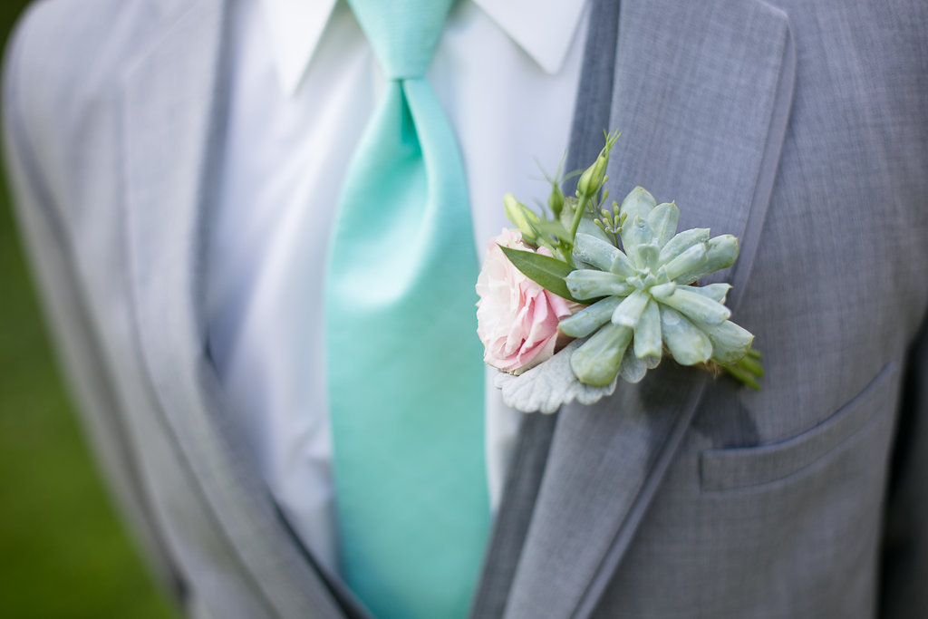Photocredit: Karlo Photography                                   Gorgeous gray with a pop of color make for a striking combo.