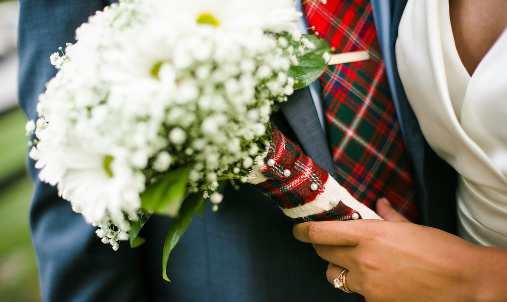 Photocredit: Karlo Photography               A tartan tie with matching pocket square is ultra chic...extra points for                                                                                                        matching the bride's bouquet wrap.