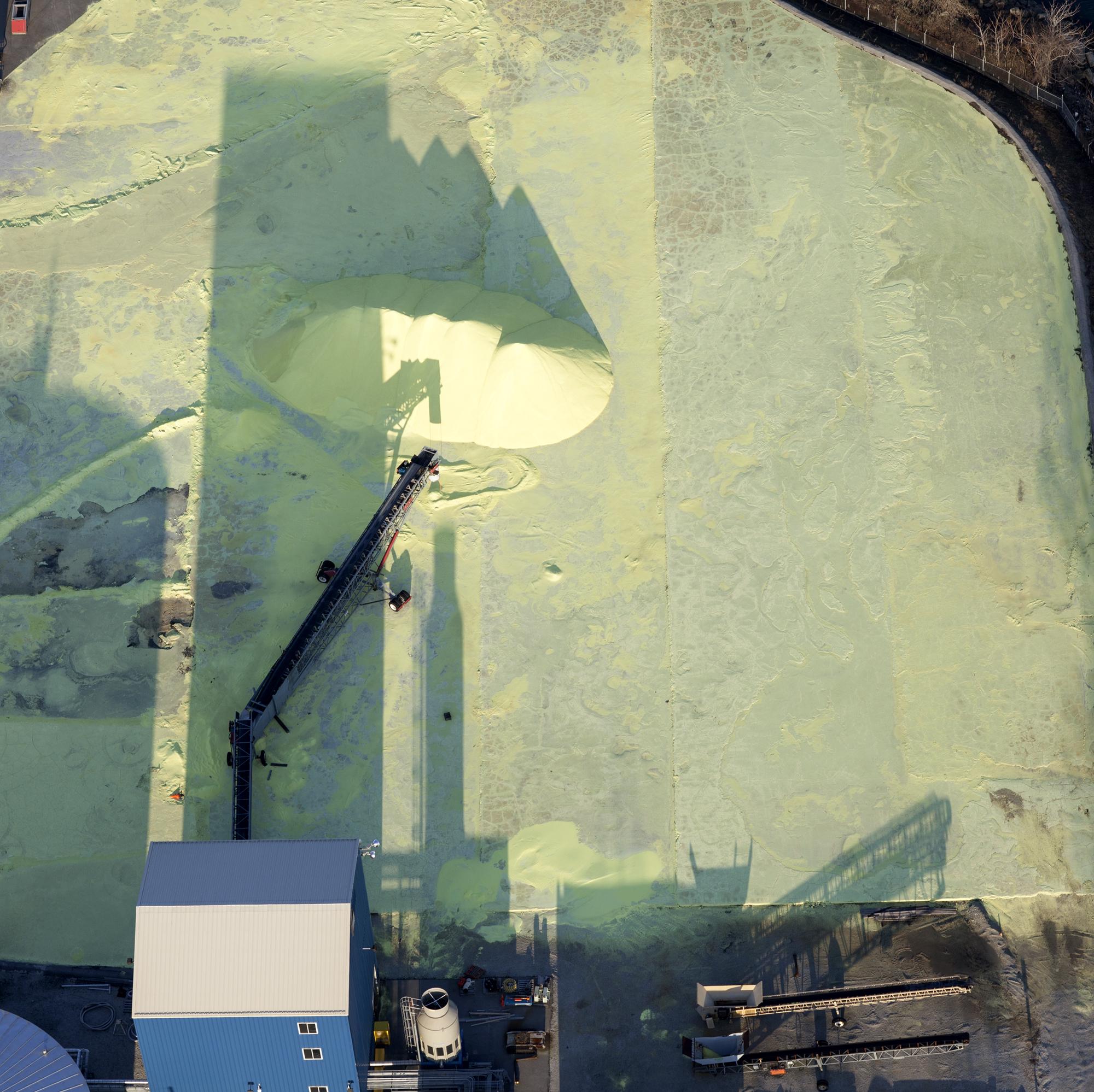 Sulphur storage, Calumet River, Southeast Chicago, 2015. Terry Evans