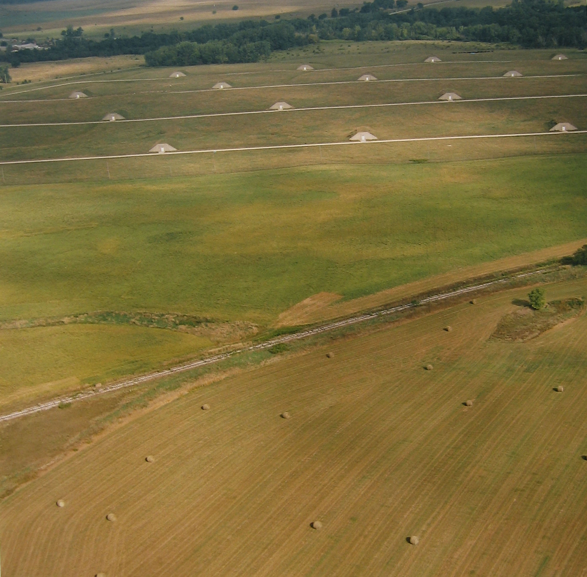 Ammunition storage bunkers and hay bales, September 9, 1995