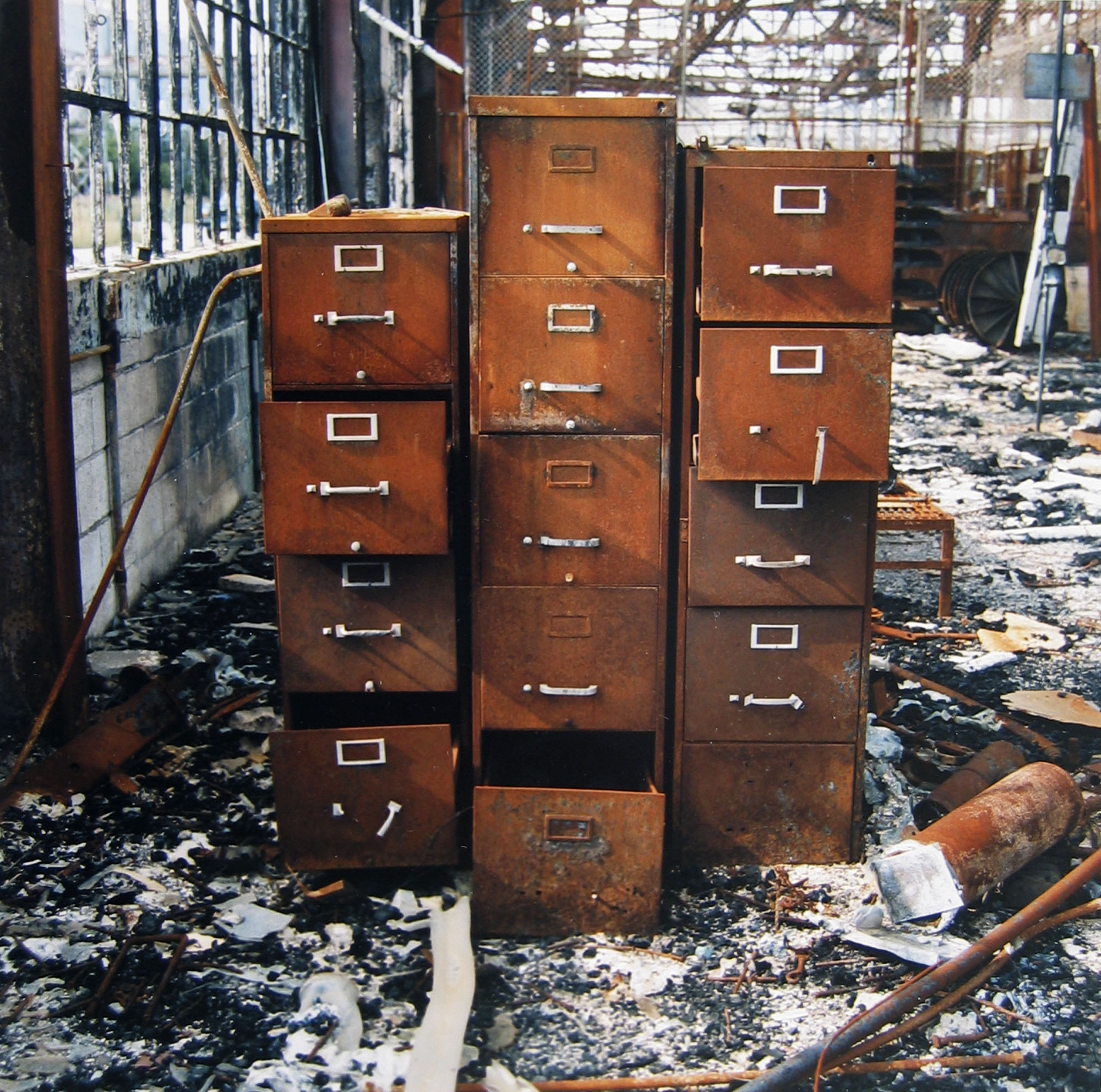 Abandoned main office building, with file cabinet, destroyed in December 1995 by fire, August 1, 1996
