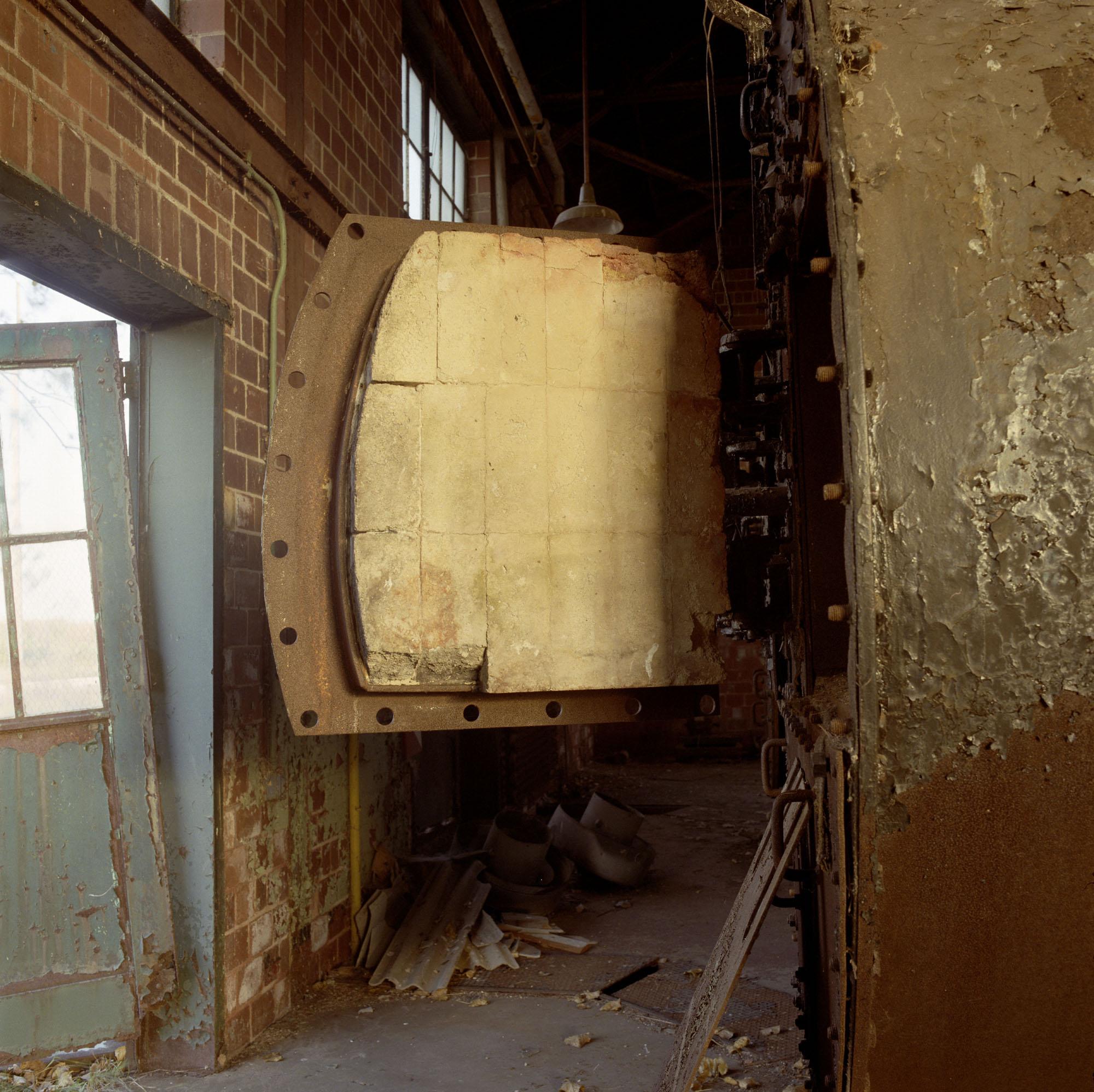 Furnace building, with door, east side, October 10, 1996