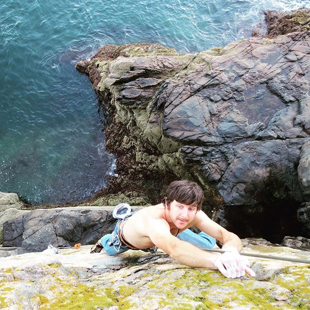 One of today's Acadian heroes, Eli Simon (@climbacadia), takes a lap on the Yellow Wall at Otter Cliffs. Eli's enthusiasm for the island is endless and his excitement for its climbing is seen in his recent bout of new route activity. #rockclimbsofacadia #climbing_pictures_of_Instagram #acadianationalpark