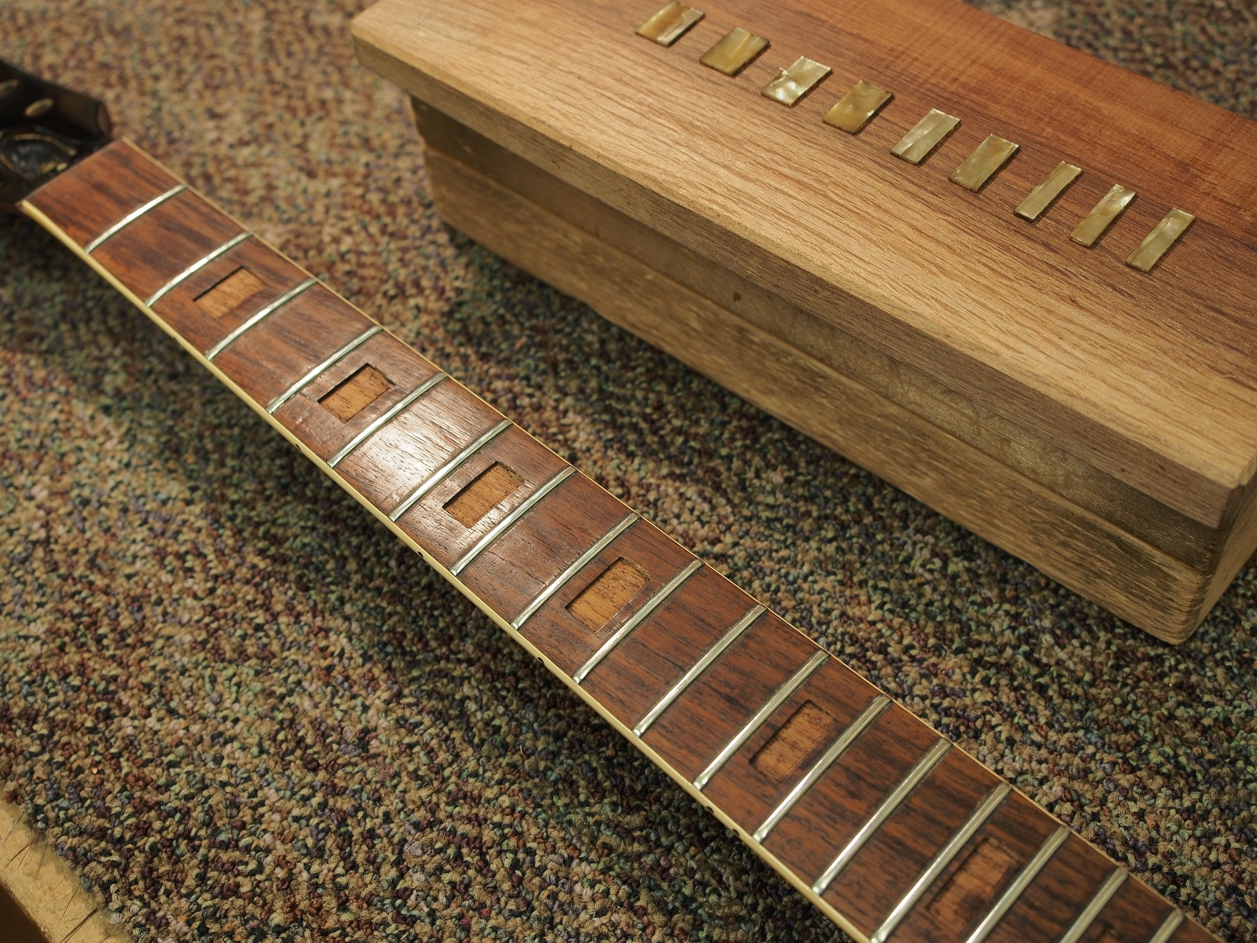 The neck removed, and the block inlays removed, and set aside for later use.