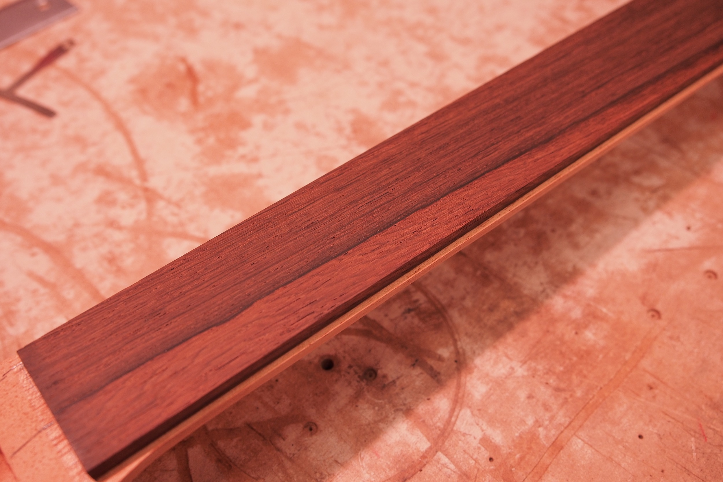 A nice shot of the new fingerboard. It's sized down, and ready for the binding, which I should have in a few days. Once I get the new binding and truss rod, it will be time for neck assembly, final neck shape to 63/64 specs, finish, and final body/neck assembly. More pictures to come!