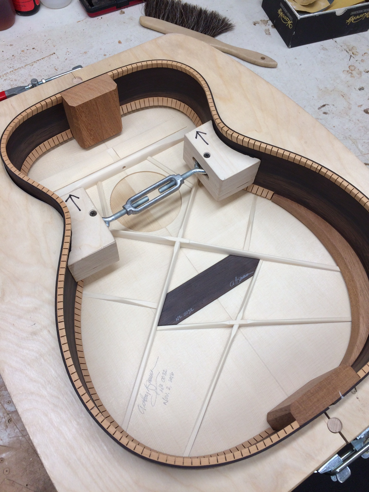 The top fully braced showing the forward shifted double X pattern with Brazilian rosewood bridge plate. This also shows how the edge bevel is supported on the interior.