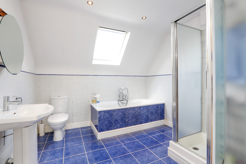grey-tiles-Family Bathroom.jpg