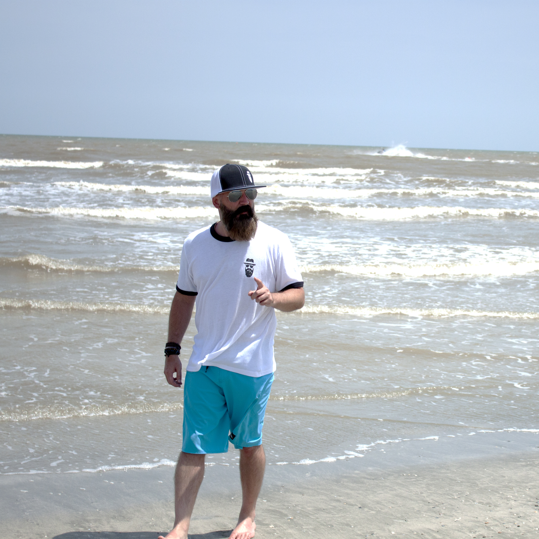 Clay sporting the CD Island Vintage Ringer Tee and the Beard On FlexFit Hat by Pacific Headwear at Galveston Beach.