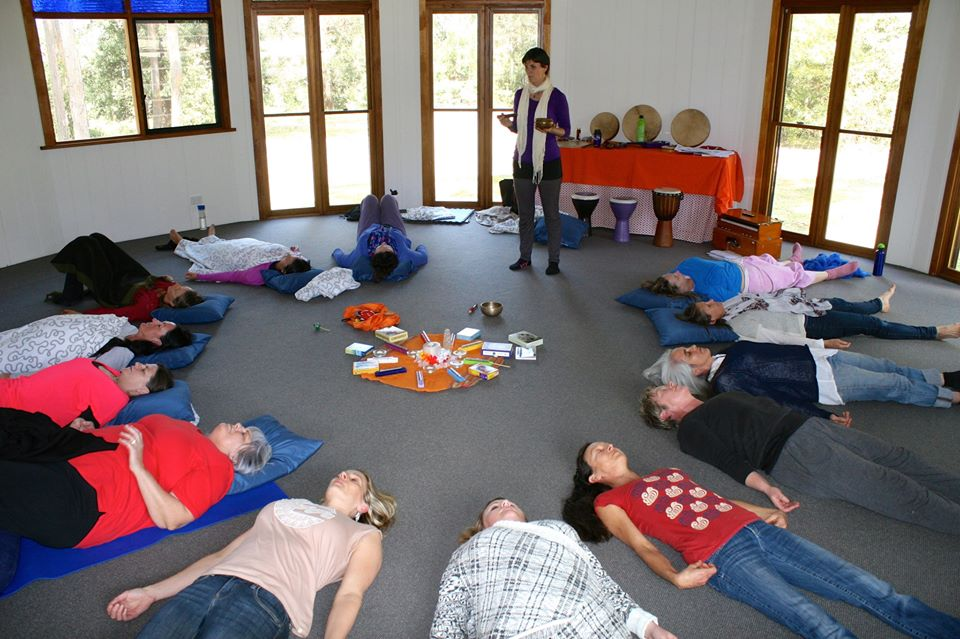 Retreat participants receiving a sound healing in the yurt