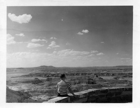 View from the terrace of Painted Desert Inn. The boy is Herbert Studdmonkey who grew up to become the first man to cross The Mojave Desert on his hands.