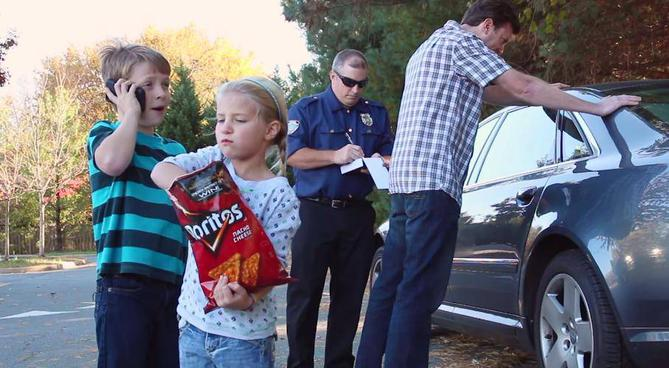 A family of 'unauthorized' Doritos smugglers. Dad takes the heat while Pip calls their attorney and Betsy tries to get rid of the evidence. A sad scene played out all across America. Note Betsy's look of defiance.